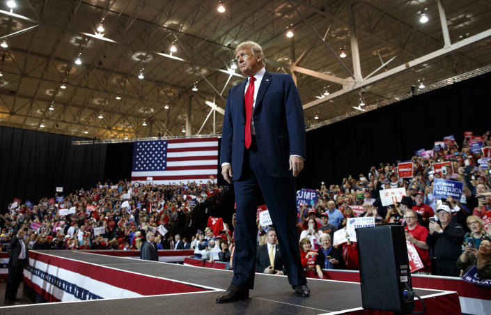 President Donald Trump arrives to speak at a rally at the IX Center, in Cleveland, Monday, Nov. 5, 2018, (AP Photo/Carolyn Kaster)