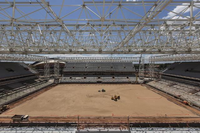 The Arena Pantanal stadium is under construction ahead of the 2014 World Cup soccer tournament in Cuiaba, Brazil, Thursday, Nov. 14, 2013. FIFA wants all World Cup stadiums completed by December. (AP Photo/Felipe Dana)