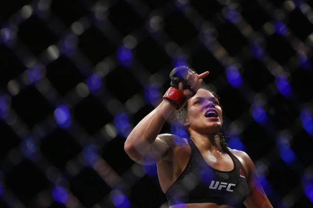 Amanda Nunes, from Brazil, celebrates after defeating Raquel Pennington, from the United States, during their UFC women's bantamweight mixed martial arts bout in Rio de Janeiro, Brazil, early Sunday, May 13, 2018. (AP Photo/Leo Correa)
