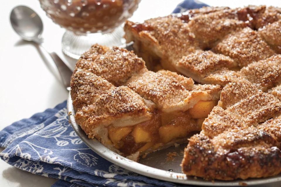 """Peach lattice is a beautifully classic summer pie. A drizzling of rich, buttery bourbon caramel over each slice heightens the naturally lush sweetness of ripe peaches—ditto a scoop of ginger ice cream (store-bought or <a href=""""https://www.epicurious.com/recipes/food/views/ginger-ice-cream-15703?mbid=synd_yahoo_rss"""" rel=""""nofollow noopener"""" target=""""_blank"""" data-ylk=""""slk:homemade"""" class=""""link rapid-noclick-resp"""">homemade</a>) on the side. <a href=""""https://www.epicurious.com/recipes/food/views/peach-lattice-pie-with-bourbon-caramel?mbid=synd_yahoo_rss"""" rel=""""nofollow noopener"""" target=""""_blank"""" data-ylk=""""slk:See recipe."""" class=""""link rapid-noclick-resp"""">See recipe.</a>"""