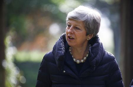 Britain's Prime Minister Theresa May leaves church near High Wycombe