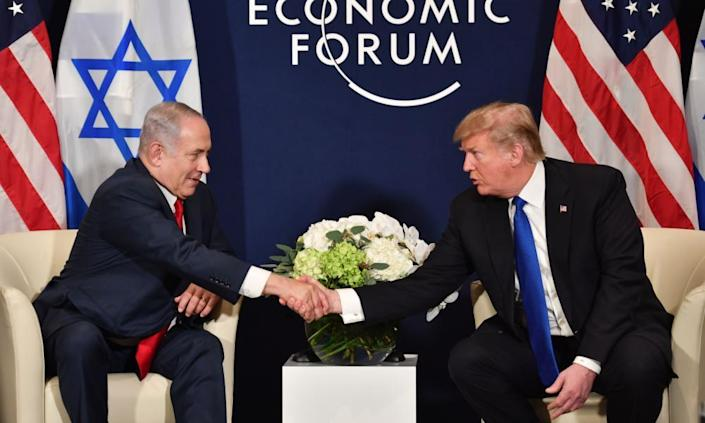 "<span class=""element-image__caption"">Donald Trump meets Benjamin Netanyahu in Davos. 'Israel has always supported the United States so what I did with Jerusalem was my honour,' said Trump.</span> <span class=""element-image__credit"">Photograph: Nicholas Kamm/AFP/Getty Images</span>"