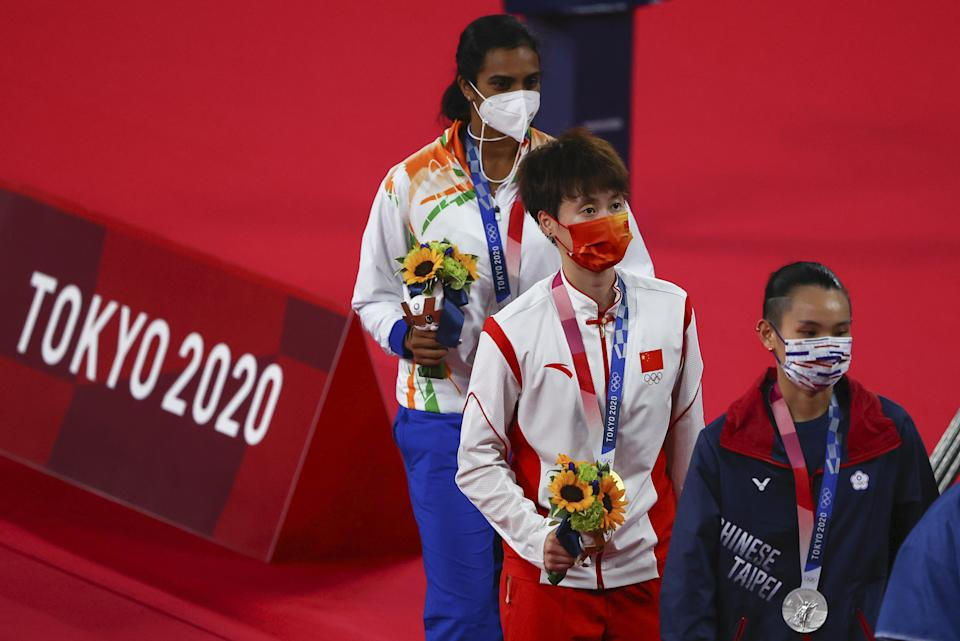 Tokyo 2020 Olympics - Badminton - Women's Singles - Medal Ceremony - MFS - Musashino Forest Sport Plaza, Tokyo, Japan – August 1, 2021. Gold medallist Chen Yufei of China, silver medallist Tai Tzu-Ying of Taiwan and bronze medallist P.V. Sindhu of India walk with their medals. REUTERS/Hamad I Mohammed