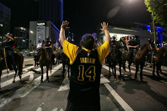 LOS ANGELES, CA - OCTOBER 11: LAPD clear the are near LA Live declaring an unlawful assembly after the Lakers 106 - 93 game 6 over the Miami Heat on Sunday, Oct. 11, 2020 in Los Angeles, CA. (Jason Armond / Los Angeles Times)