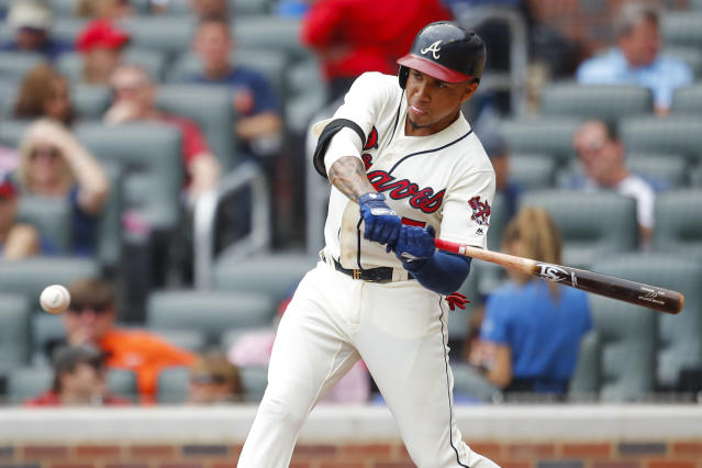 Atlanta Braves Johan Camargo (17) hits a single to bring in a run in the first inning of a baseball game against the Colorado Rockies, Sunday, Aug. 19, 2018, in Atlanta. (AP Photo/Todd Kirkland)