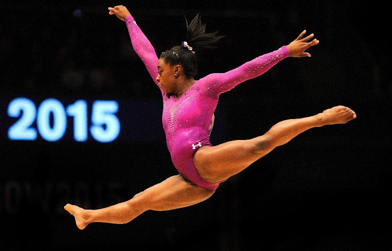 Simone Biles had a challenging early life, born to a mother with a drug and alcohol addiction and adopted and raised by her grandparents at the age of three (AFP Photo/Andy Buchanan)