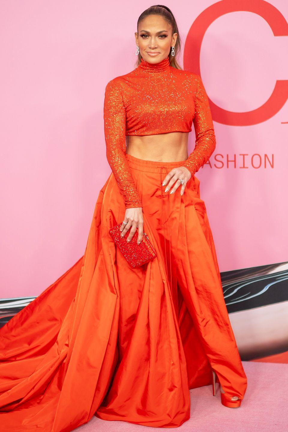 """<p>Who: Jennifer Lopez </p><p>When: June 03, 2019</p><p>Wearing: Ralph Lauren</p><p>Why: Abs. <em>Abs. </em>ABS. While Jennifer Lopez was awarded the <a href=""""https://www.elle.com/culture/celebrities/a27705252/jennifer-lopez-dress-cfda-fashion-awards-2019/"""" rel=""""nofollow noopener"""" target=""""_blank"""" data-ylk=""""slk:Fashion Icon award this week at the CFDA Fashion Awards"""" class=""""link rapid-noclick-resp"""">Fashion Icon award this week at the CFDA Fashion Awards</a> in Brooklyn, New York, we were awarded with a deep mistrust of our current core workout routine. She styled her abdominal muscles with an archived look from Ralph Lauren's Fall 1999 collection, thus winning her—and again, her abs—ELLE.com's best dressed celeb of the week. </p>"""