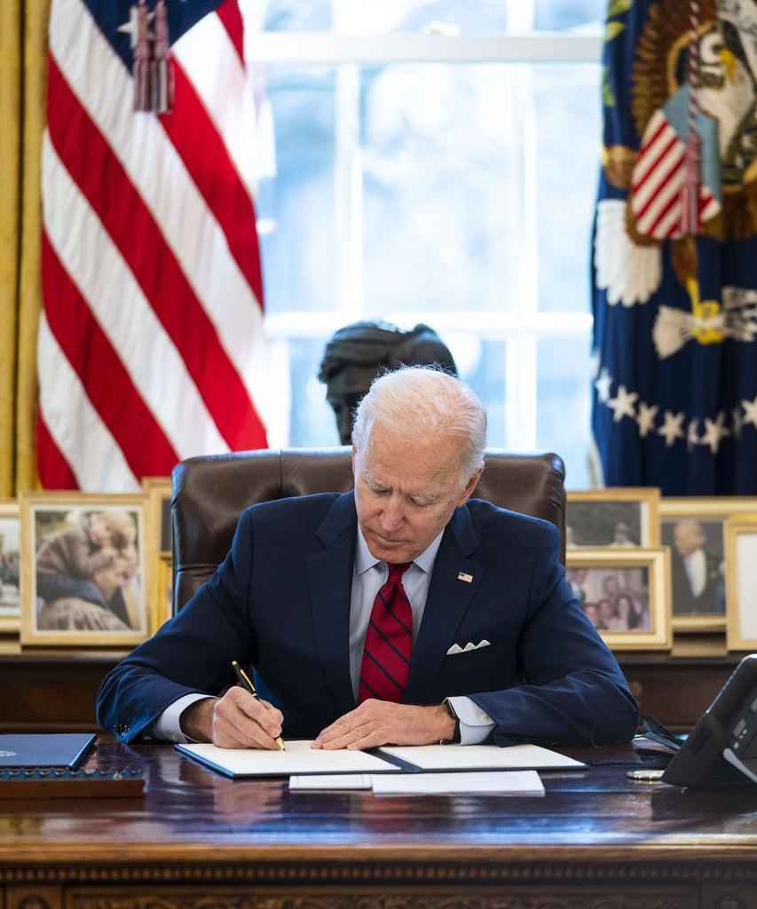 Mandatory Credit: Photo by Shutterstock (11734094b) United States President Joe Biden signs executive orders strengthening Americans' access to quality, affordable health care, in the Oval Office of the White House in Washington, DC,. Biden Signs Executive Actions Strengthening Americans' Access to Quality, Affordable Health Care, Washington, District of Columbia, USA – 28 Jan 2021