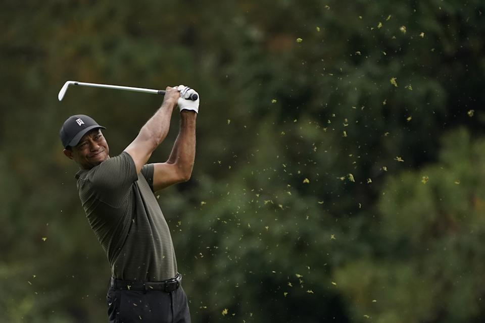 Tiger Woods hits on the 15th fairway during the first round of the Masters.