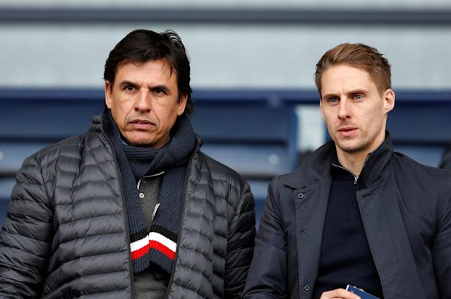 "Soccer Football - League One - Shrewsbury Town vs AFC Wimbledon - Montgomery Waters Meadow, Shrewsbury, Britain - March 24, 2018 Sunderland manager Chris Coleman and Reading player Dave Edwards in the crowd Action Images/Ed Sykes EDITORIAL USE ONLY. No use with unauthorized audio, video, data, fixture lists, club/league logos or ""live"" services. Online in-match use limited to 75 images, no video emulation. No use in betting, games or single club/league/player publications. Please contact your account representative for further details."