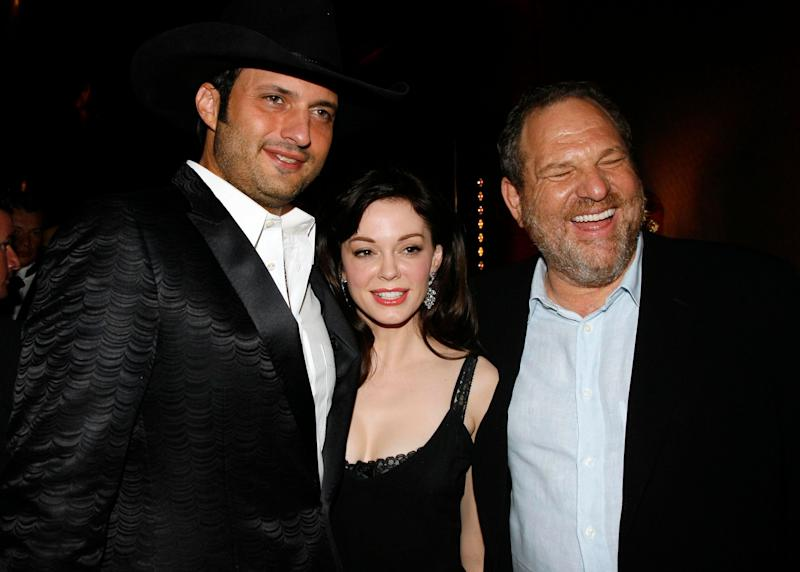 """<br /> Rose McGowan (center) poses with director and then-boyfriend Robert Rodriguez (left) and Harvey Weinstein (right) in 2007. Last year, McGowan tweeted that """"her ex sold our movie to my rapist for distribution."""" Some have speculated that she was referring to Rodriguez and Weinstein, respectively."""