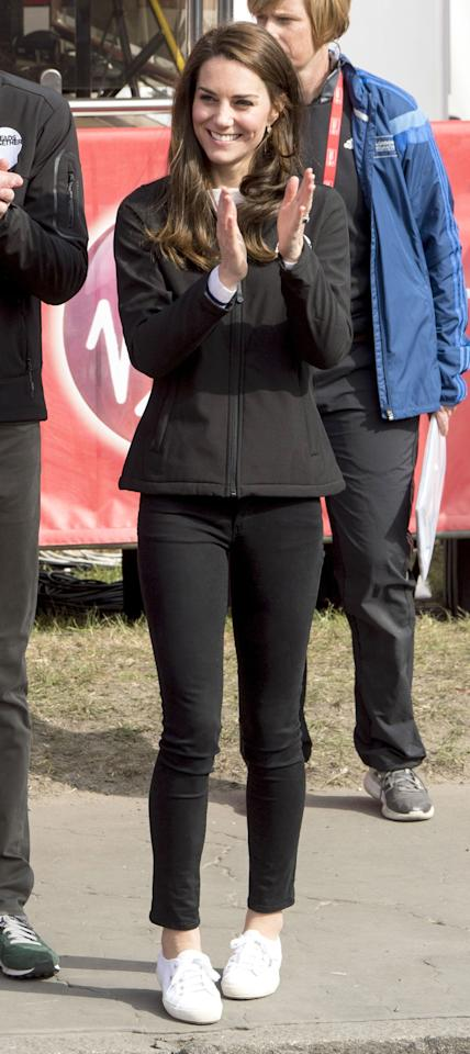 <p>In azip-up jacket with black cropped jeans and Superga sneakers at the bluestart of the Virgin Money London Marathon.</p>