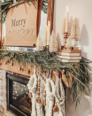 "<p>Browns, creams, and greens give this Christmas mantel an upscale country vibe. We love the idea of adding a kraft paper scroll to write out your favorite holiday phrase or greeting. (If you don't love your handwriting, use stamps or stencils for a cleaner finish.) </p><p><em>See more at <a href=""https://www.instagram.com/p/B6BuWFOgF_-/"" rel=""nofollow noopener"" target=""_blank"" data-ylk=""slk:Rustic Rose Homestead"" class=""link rapid-noclick-resp"">Rustic Rose Homestead</a>. </em></p><p><a class=""link rapid-noclick-resp"" href=""https://www.amazon.com/Kraft-Paper-Roll-150ft-Brown/dp/B07M7WVT35?tag=syn-yahoo-20&ascsubtag=%5Bartid%7C10072.g.34484299%5Bsrc%7Cyahoo-us"" rel=""nofollow noopener"" target=""_blank"" data-ylk=""slk:SHOP KRAFT PAPER ROLL"">SHOP KRAFT PAPER ROLL</a></p>"