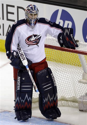 Columbus Blue Jackets goalie Steve Mason (1) pauses after giving up a goal by San Jose Sharks center Joe Pavelski, not shown, in the second period in an NHL hockey game in San Jose, Calif., Tuesday, Jan. 31, 2012. (AP Photo/Paul Sakuma)