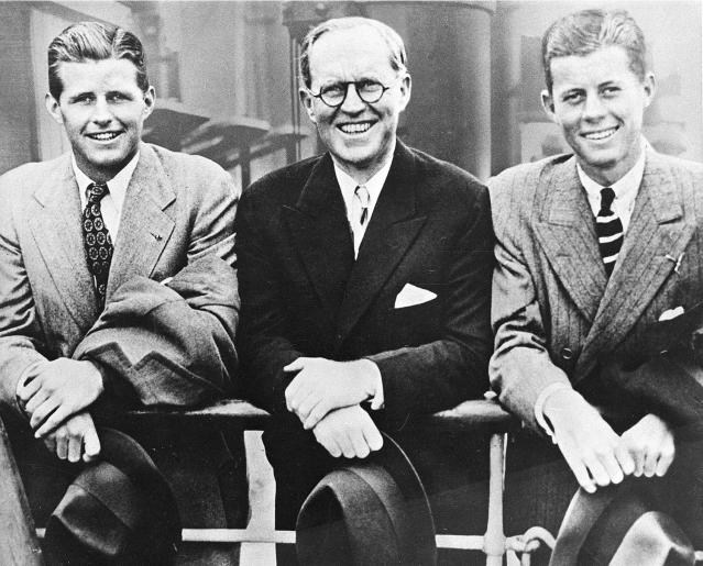 <p>U.S. Ambassador to Great Britain Joseph P. Kennedy, center, is flanked by his sons, Joseph P. Kennedy Jr., left, and John F. Kennedy, right, as he poses aboard an ocean liner in this 1938 photograph. (Photo: AP) </p>