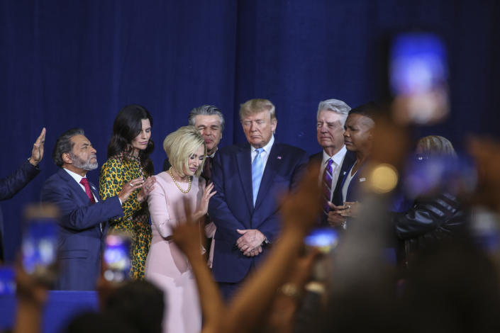 Religious leaders pray over President Trump before he addresses the congregation at the El Rey Jesus church. President Donald Trump holds an Evangelicals for Trump rally at the El Rey Jesus megachurch in south Miami to show up support among his evangelical base in the key swing state of Florida. (Adam DelGiudice/Echoes Wire/Barcroft Media via Getty Images)