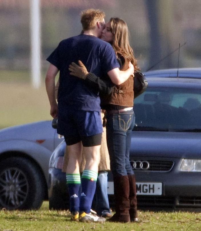 <p>Engaging in some rare PDA with Prince William in 2006. </p>