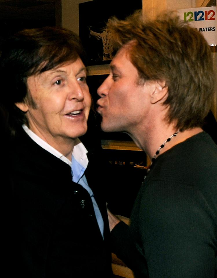 "NEW YORK, NY - DECEMBER 12:  (Exclusive Coverage) Sir Paul McCartney and Jon Bon Jovi backstage during ""12-12-12"" a concert benefiting The Robin Hood Relief Fund to aid the victims of Hurricane Sandy presented by Clear Channel Media & Entertainment, The Madison Square Garden Company and The Weinstein Company at Madison Square Garden on December 12, 2012 in New York City.  (Photo by Kevin Mazur/WireImage for Clear Channel)"
