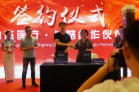 Zhao Baihui, center right, CEO of Shanghai-based testing kit company BioGerm, shakes hands after signing a partnership agreement during a corporate event at a trade fair in Nanchang in eastern China's Jiangxi province on Saturday, Aug. 22, 2020. BioGerm was one of three companies that gained privileged access to crucial information on the coronavirus from the Chinese Center for Disease Control and Prevention at the beginning of the outbreak, allowing them to make kits ahead of competitors. The move delayed China's response to the outbreak and caused critical shortages of kits. (AP Photo/Dake Kang)