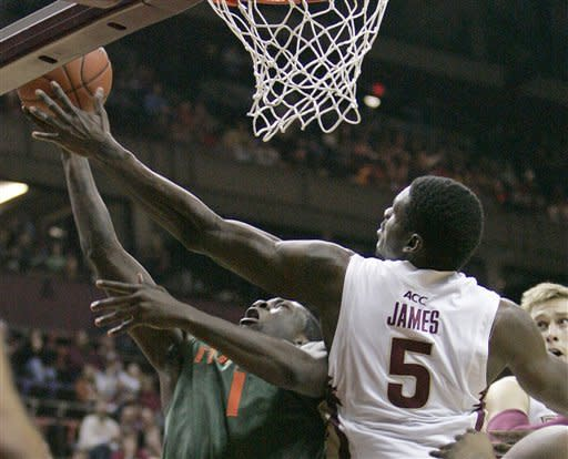 Florida State's Bernard James blocks the shot of Miami's Durand Scott in the first half of an NCAA college basketball game on Saturday, Feb. 11, 2012 in Tallahassee, Fla.(AP Photo/Steve Cannon)