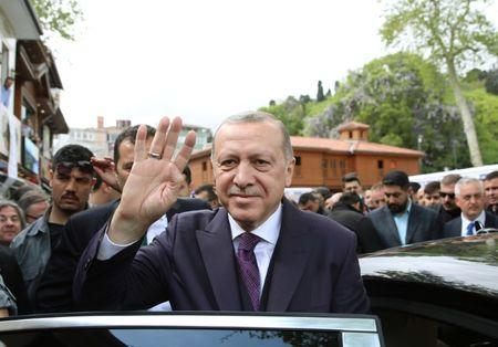 Turkish President Erdogan greets his supporters as he leaves from a mosque after the Friday prayers in Istanbul
