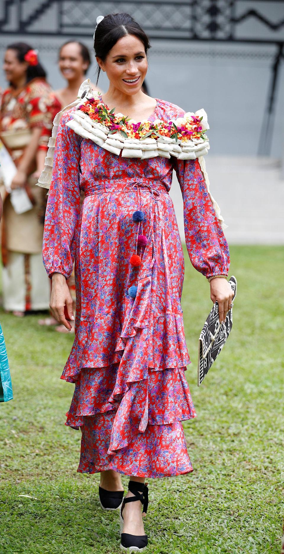 <p>For a morning tea reception at the British High Commissioners Residence in Fiji, the Duchess of Sussex dressed her bump in a £1,155 pom pom dress by New York-based designer Figue. <em>[Photo: Getty]</em> </p>
