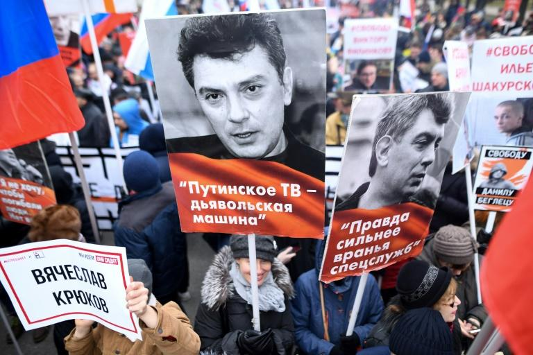 Opposition supporters attend a march in memory of murdered Kremlin critic Boris Nemtsov in downtown Moscow. It is the first such rally since Russia's Vladimir Putin announced controversial changes to the constitution in January