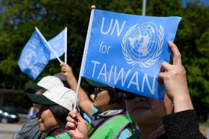 A pro-Taiwan protester holds a flag outside of the United Nations offices on the opening day of the World Health Organization's annual meeting in Geneva on May 22, 2017. | Fabrice Coffrini—AFP/Getty Images