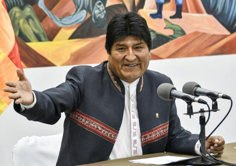 President Evo Morales, declared the winner of recent elections in Bolivia, speaks to reporters in La Paz on October 24 (AFP Photo/AIZAR RALDES)