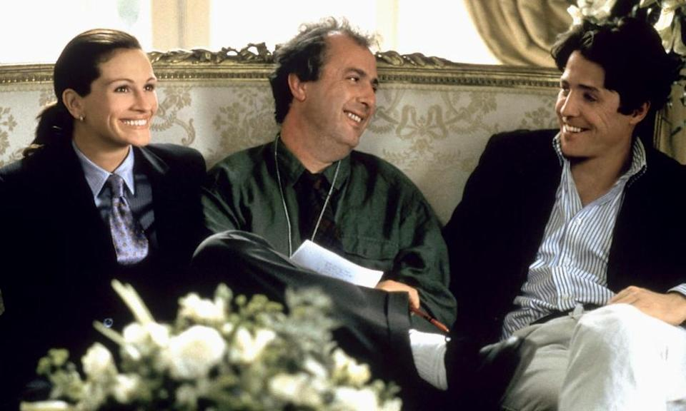 Roger Michell, centre, with Hugh Grant and Julia Roberts on the set of Notting Hill, 1999.