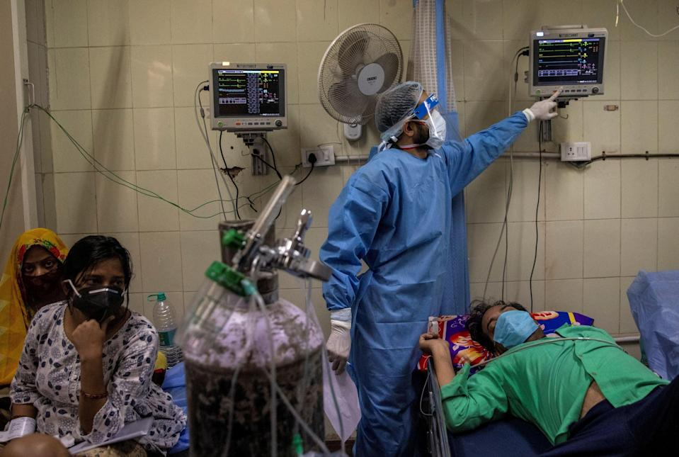 <p>Coronavirus patients are treated at the casualty ward in Lok Nayak Jai Prakash Hospital amid the spread of the disease in New Delhi</p> (Reuters)
