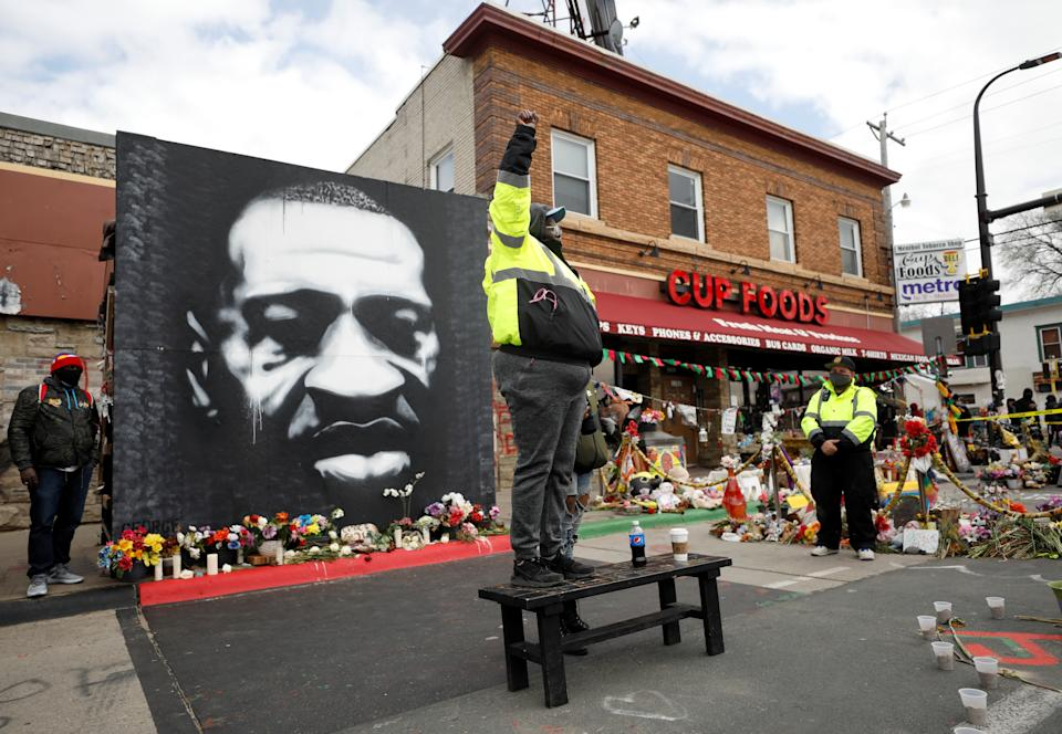 A man gestures on a bench, as the verdict announcement is expected in the trial of former Minneapolis police officer Derek Chauvin, who is facing murder charges in the death of George Floyd, at the George Floyd Square in Minneapolis, Minnesota, U.S., April 20, 2021. REUTERS/Octavio Jones