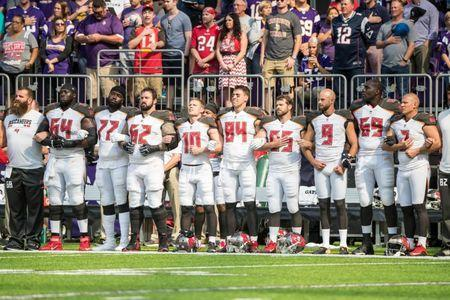 Sep 24, 2017; Minneapolis, MN, USA; Members of the Tampa Bay Buccaneers link arms during the national anthem prior to the game against the Minnesota Vikings at U.S. Bank Stadium. Mandatory Credit: Brace Hemmelgarn-USA TODAY Sports