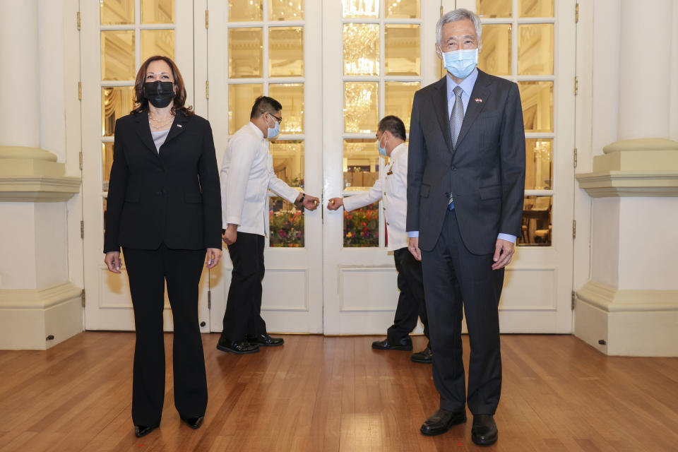 U.S. Vice President Kamala Harris, left, stands next to Singapore's Prime Minister Lee Hsien Loong before their bilateral meeting at the Istana in Singapore Monday, Aug. 23, 2021. (Evelyn Hockstein/Pool Photo via AP)