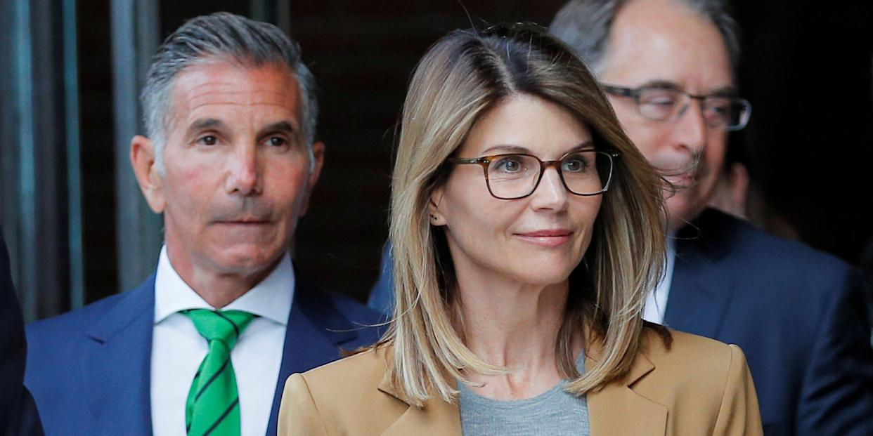 Actor Lori Loughlin, and her husband, fashion designer Mossimo Giannulli, leave the federal courthouse after facing charges in a nationwide college admissions cheating scheme, in Boston, Massachusetts,.JPG