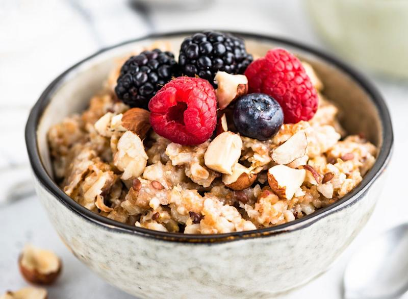 High fiber breakfast whole grain oatmeal with fresh berries nuts and seeds
