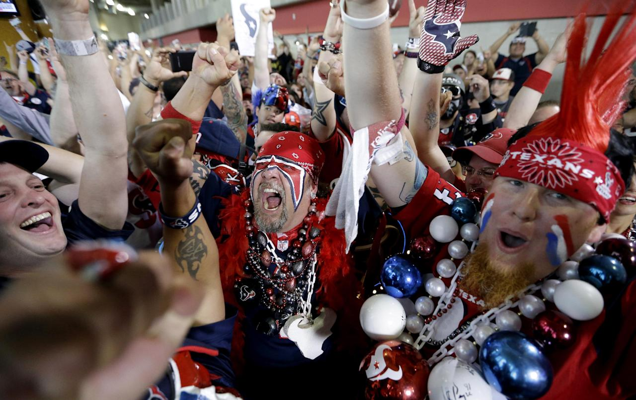 Houston Texans fans celebrate after the Houston Texans chose South Carolina defensive end Jadeveon Clowney as the number one overall pick in the NFL draft Thursday, May 8, 2014, in Houston. (AP Photo/David J. Phillip)