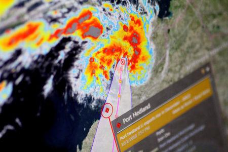A cyclone is shown approaching Port Hedland, Australia, on an Eikon ship-tracking screen in this illustration photo January 11, 2018.      REUTERS/Thomas White/Illustration