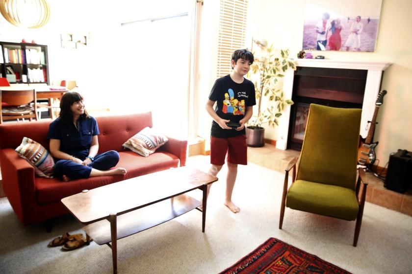 LOS ANGELES, CA - APRIL 29: Deborah Netburn plays the video game Undertale with her 13-year-old son at home on April 29, 2021, in Los Angeles, California. Netburn learned how to play video games as a route to connect more deeply with her son instead of resenting the time he spent with them. (Dania Maxwell / Los Angeles Times)