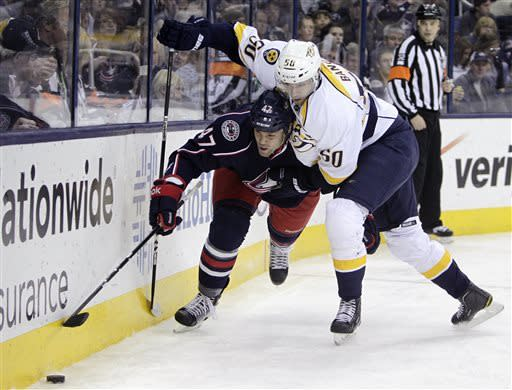Nashville Predators' Daniel Bang, right, of Sweden, and Columbus Blue Jackets' Dalton Prout chase a loose puck during the first period of an NHL hockey game on Saturday, April 27, 2013, in Columbus, Ohio. (AP Photo/Jay LaPrete)