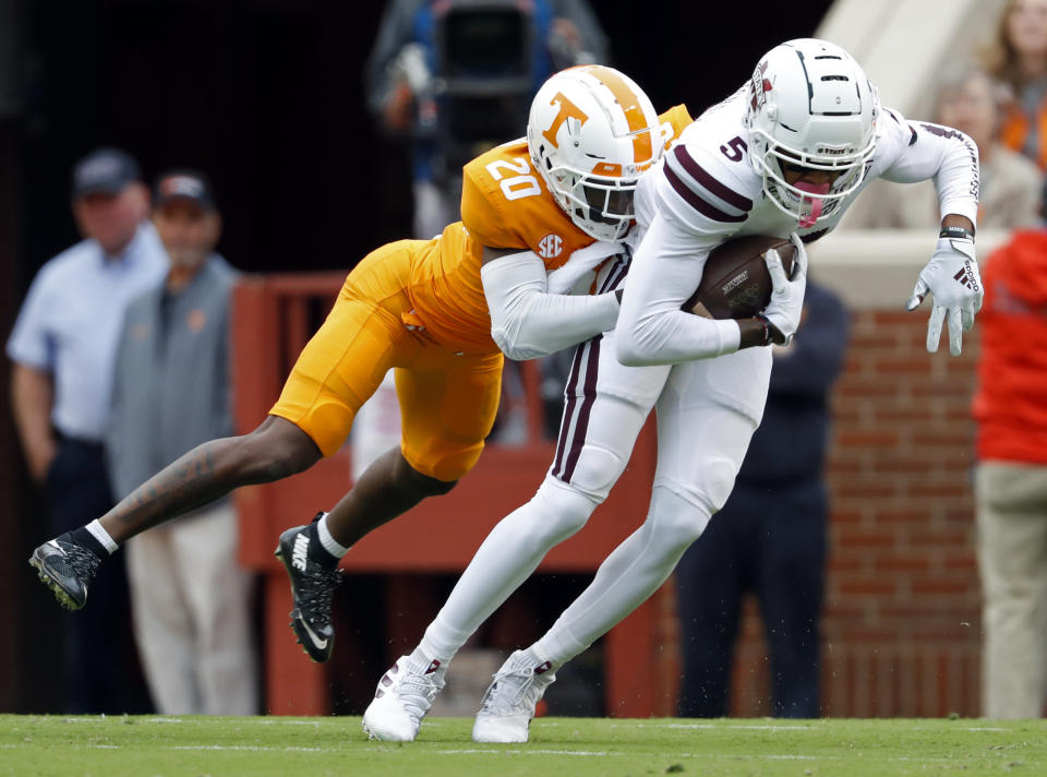 Mississippi State wide receiver Osirus Mitchell (5) is tackled by Tennessee defensive back Bryce Thompson (20) in the first half of an NCAA college football game Saturday, Oct. 12, 2019, in Knoxville, Tenn. (AP Photo/Wade Payne)