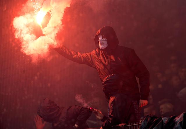Soccer Football - Bundesliga - Hamburger SV v Borussia Moenchengladbach - Volksparkstadion, Hamburg, Germany - May 12, 2018 General view of a fan with a flare REUTERS/Fabian Bimmer DFL RULES TO LIMIT THE ONLINE USAGE DURING MATCH TIME TO 15 PICTURES PER GAME. IMAGE SEQUENCES TO SIMULATE VIDEO IS NOT ALLOWED AT ANY TIME. FOR FURTHER QUERIES PLEASE CONTACT DFL DIRECTLY AT + 49 69 650050