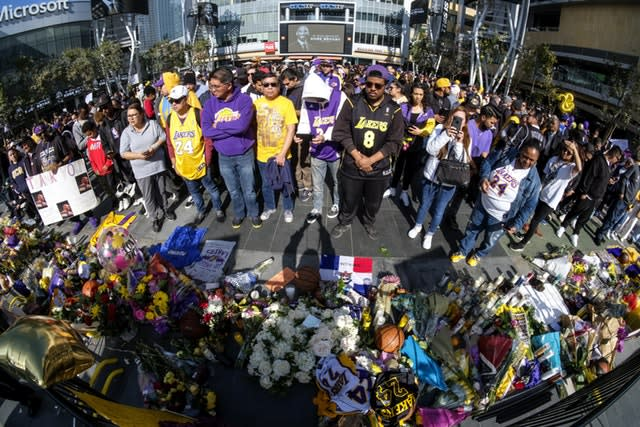 People gather at a memorial for Kobe Bryant near Staples Center (Ringo H.W. Chiu/AP)
