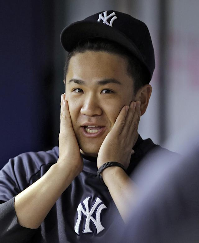 New York Yankees pitcher Masahiro Tanaka, of Japan, wipes his face during the first inning of a baseball game against the Tampa Bay Rays Friday, Aug. 15, 2014, in St. Petersburg, Fla. Tanaka is scheduled to throw a bullpen session tomorrow. (AP Photo/Chris O'Meara)