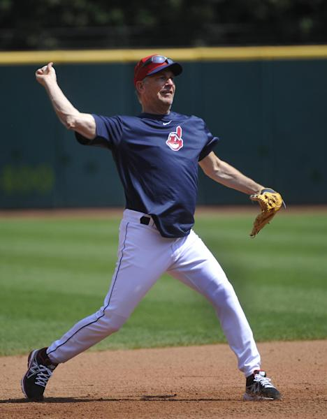 """Actor Kevin Costner makes a throw to first base while taking infield warm-ups with the Cleveland Indians before their game against the Minnesota Twins, in Cleveland, Sunday, June 23, 2013. Costner has been in Cleveland filming scenes for the movie """"Draft Day""""(AP Photo/Phil Long)"""