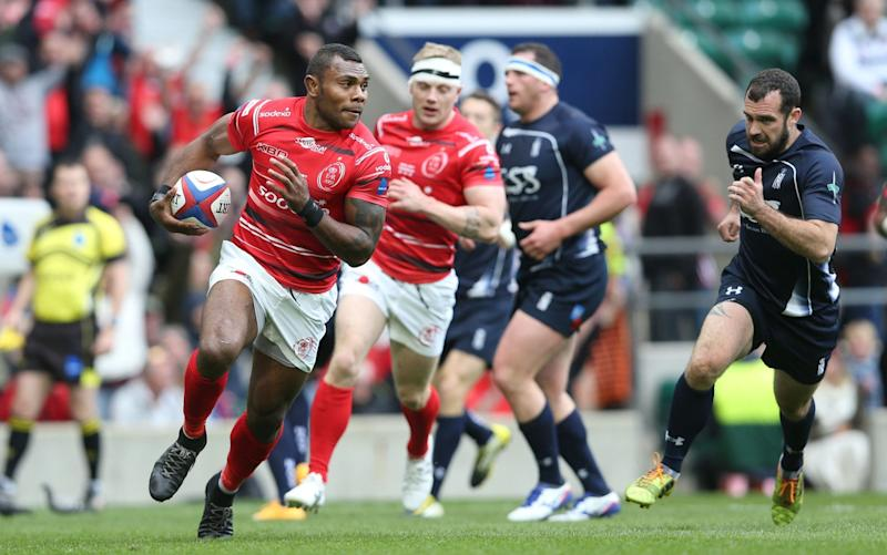 Semesa Rokoduguni scores the Army's first try against the Navy at Twickenham last year - Rex Features