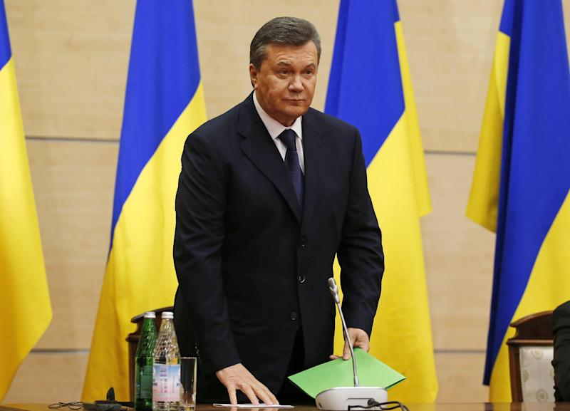 Ukraine's fugitive president Viktor Yanukovych gives a news conference in Rostov-on-Don, a city in southern Russia about 1,000 kilometers (600 miles) from Moscow, Friday, Feb. 28, 2014. Ukrainian fugitive president appears for first time since Saturday at Russia news conference. (AP Photo/Pavel Golovkin)