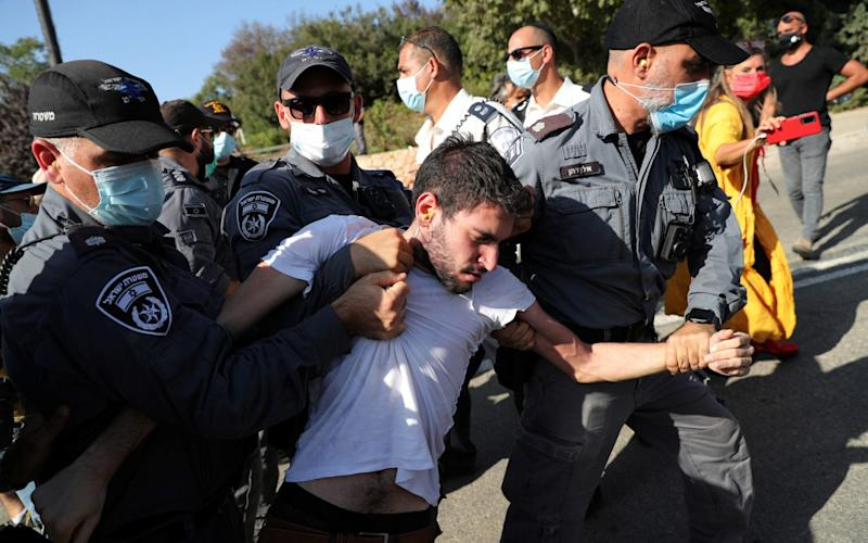 Protesters scuffle with police during anti-government demonstrations  - Ronen Zvulun/Reuters