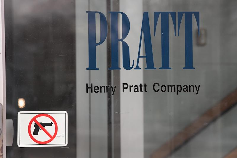 A sign on the front door of the Henry Pratt Company office shows that guns are not allowed in the building on February 16, 2019 in Aurora, Illinois. Yesterday five people were killed and 5 police officers were wounded by a former employee armed with a handgun in the company's manufacturing plant. The gunman, who was killed by police, has been identified as Gary Martin.