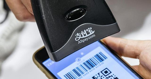 Chinese consumers pay merchants by scanning QR codes. Anthony Kwan | Bloomberg | Getty Images